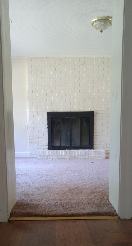 Entry to Family Room with Fireplace